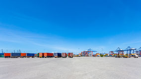 Landscape of truck, containers and crane at trade port Stock Photos