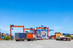 Landscape of truck, containers and crane at trade port Royalty Free Stock Photo