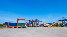 Landscape of truck, containers and crane at trade port Stock Photography