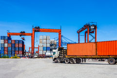 Landscape of truck, containers and crane at trade port Royalty Free Stock Photography