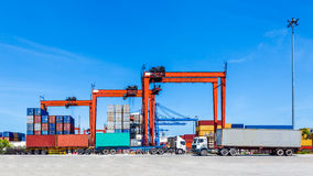 Landscape of truck, containers and crane at trade port Stock Image