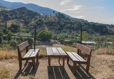 Landscape of  Turkish mountains with a wooden table and benches Royalty Free Stock Photography