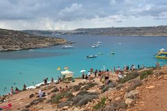 Malta, Comino: Famous, scenic Blue Lagoon Beach. Landscape of turquoise water at Blue Lagoon Beach at Comino Island, Malta. The Beach is one of the famous and Royalty Free Stock Photo