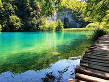 Landscape with turquoise water and mountains, beautiful view of the lake. Plitvice Lakes royalty free stock photography