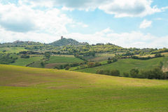 Landscape of tuscan countryside and Castiglione d`Orcia fortress Stock Images