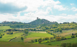 Landscape of tuscan countryside and Castiglione d`Orcia fortress Royalty Free Stock Images