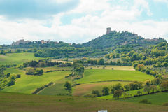 Landscape of tuscan countryside and Castiglione d`Orcia fortress Royalty Free Stock Photography