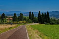 Landscape in Tuscany with cypresses and road stock photography