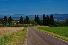 Landscape in Tuscany with cypresses and road stock image