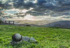 Landscape in tuscany. The sun's rays filter through the dark clouds in the morning panorama of the Tuscan hills Royalty Free Stock Photos