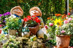 Landscape with two funny garden gnomes among colorful flowerpots in the Spreewald Biosphere Reserve, Brandenburg, near Berlin, Ge. Landscape with two funny stock photography