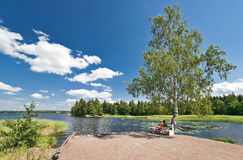 Landscape with two girls under birch tree Royalty Free Stock Photo