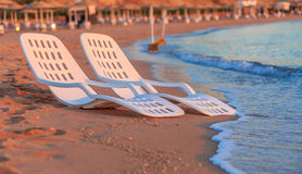 Landscape of Two Lonely beachchairs near sea and beautiful sunrise Stock Images