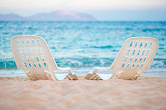 Landscape of Two Lonely beachchairs near the sea Royalty Free Stock Photo