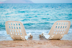 Landscape of Two Lonely beachchairs near the sea Stock Photo