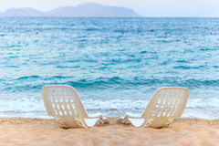 Landscape of Two Lonely beachchairs near the sea Royalty Free Stock Images