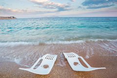 Landscape of Two Lonely beachchairs near the sea Royalty Free Stock Image