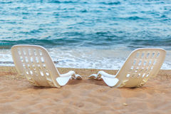Landscape of Two Lonely beachchairs near the sea Royalty Free Stock Photos