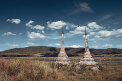 Landscape with two lonely Buddhist stupas in the background of h Stock Photos