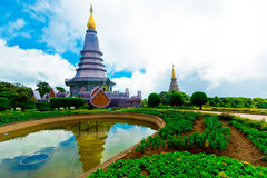 Landscape of two pagodas Noppamethanedol & Noppapol Phumsiri in Stock Photos