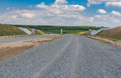 Landscape in Ukraine with stone layer of unfinished highway near Dnepr city Stock Image