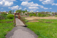 Landscape in Ukrainian country with small foot-bridge Royalty Free Stock Photos