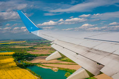 Landscape under airplane wing Royalty Free Stock Images