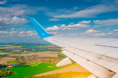 Landscape under airplane wing Stock Images