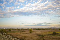 Landscape of Vacaresti Natural Park, Bucharest, Romania. Autumn field with wetlands and green grass with dry plants or thatch, blue sky with clouds, landscape Stock Images