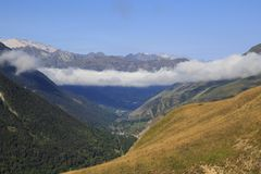 Foggy landscape in Aran Valley, Catalonia, Spain. Landscape in Vall d`aran, a valley in Catalan Pyrenees, Spain Royalty Free Stock Images