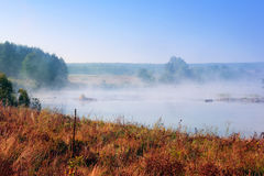 Landscape of the valley, the river with dense fog Stock Photography