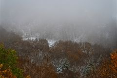 Landscape valley in the winter with fog royalty free stock photography