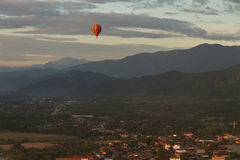 Landscape of Vang Vieng, Laos - Hot air baloon in the sky Stock Image