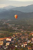 Landscape of Vang Vieng, Laos - Hot air baloon in the sky Stock Photo