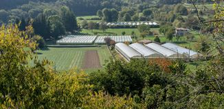 Landscape with vegetable and fruit growing areas. And foil tents in Italy royalty free stock photo