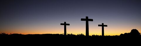 Landscape View of 3 Cross Standing during Sunset Stock Image