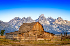 Landscape view of abandoned barn and mountain range, Grand Teton Stock Images