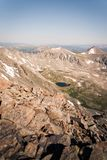 Landscape view of alpine lake surrounded by mountains from the top of Quandary Peak in Colorado. royalty free stock images