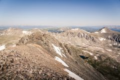 Landscape view of alpine lake surrounded by mountains from the top of Quandary Peak in Colorado. stock photos