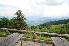Landscape view of Mountains from resting place with tabl. Landscape view of the Alps Mountain from resting place with table and bench royalty free stock photos