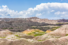 Landscape view of Badlands National Park with curved road and cars Royalty Free Stock Photo