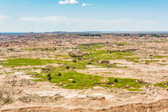 Landscape view of Badlands National Park with green grass and prairie Stock Photo