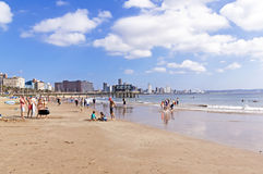 Landscape view of beach and city skyline Stock Images