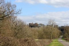 A landscape view of Belvoir Castle, UK. A view of Belvoir Castle, Leicestershire UK, from a distance on a spring day Stock Photo