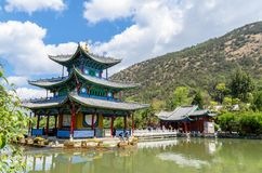 Landscape view of the Black Dragon Pool, it is a famous pond in the scenic Jade Spring Park located at the foot of Elephant Hill. Lijiang,China - April 11,2017 Royalty Free Stock Photography