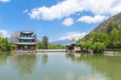 Landscape view of the Black Dragon Pool, it is a famous pond in the scenic Jade Spring Park located at the foot of Elephant Hill. Lijiang,China - April 11,2017 Stock Photography