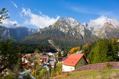 View of Busteni city and Bucegi Mountains. Landscape view of Bucegi Mountains and Busteni City in a beautiful sunny autumn day Stock Images
