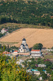 Landscape view with Capriana Monastery and the village around Royalty Free Stock Images