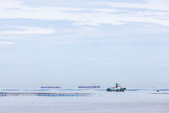 Landscape view of Cargo shipping and Fisherman's boat in the S Stock Photos