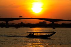 Landscape View Chao Phraya River with twilight light of sunset and boat on river with the bridge. Background Bangkok Thailand stock images